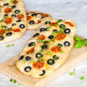 Focaccia bread with olives, cheese and cherry tomatoes
