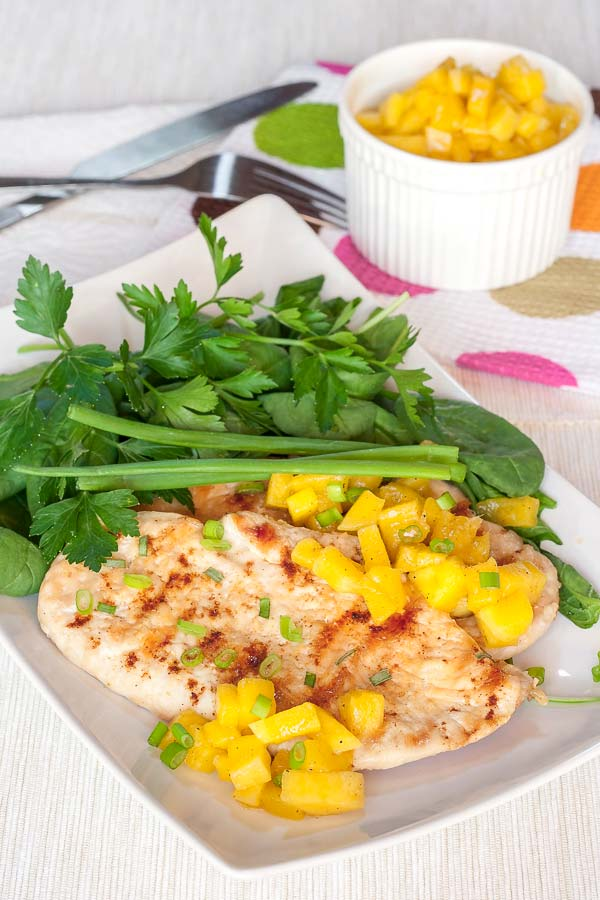Delicious grilled chicken served with a home-made mango salsa